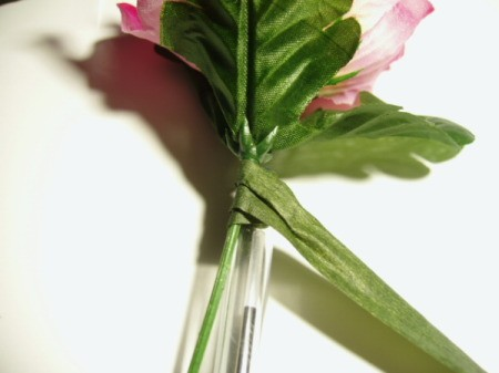 Wrapping floral tape around stem.