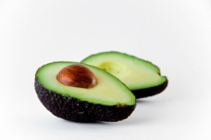 An avocado cut in half.