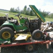 Riding mower on trailer.