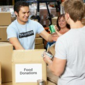 Volunteers accepting food donations.