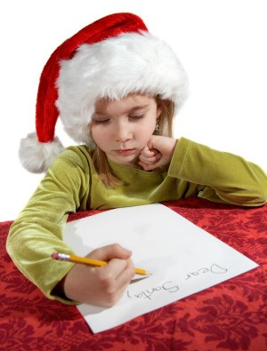 A girl writing a Christmas wish list.