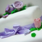 Engagement cake with flowers on it.