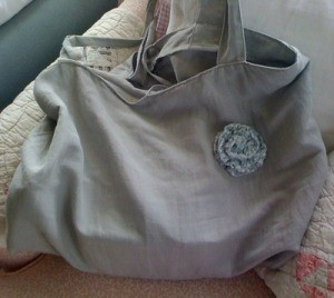 Rose pin on cloth purse.