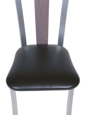 Dining room chair with a vinyl seat.