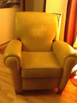 Yellow vinyl recliner.