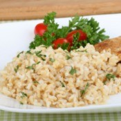 A plate of cooked brown rice.