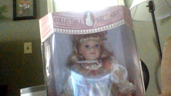 Doll in box.
