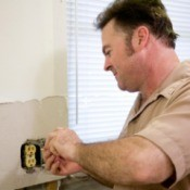 Man fixing and electrical outlet