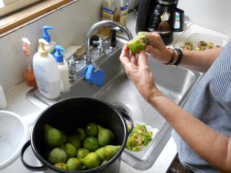 Peeling figs.