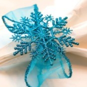 Blue ribbon and snowflake napkin ring