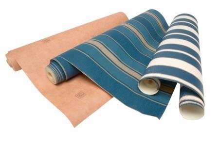 Three rolls of wallpaper.