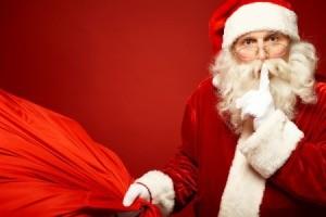 Santa and his bag whispering hush.