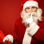 Santa and his bag whispering hush.