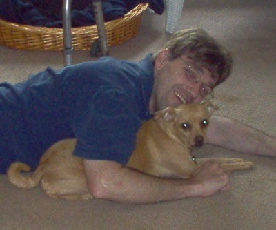 Man lying over dog.