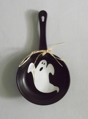 Ghost painted inside of case iron skillet.