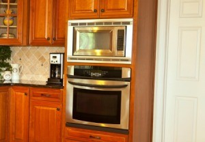 A kitchen with a brand new oven.