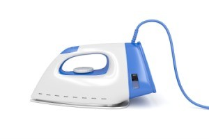 Blue and white clothes iron.