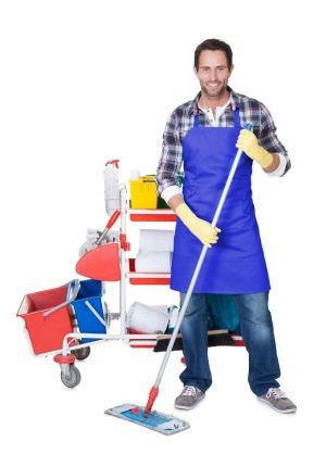 A professional cleaner with his cleaning supplies.