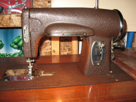 Dark brown vintage sewing machine.