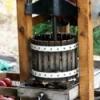 An apple press making apple juice.