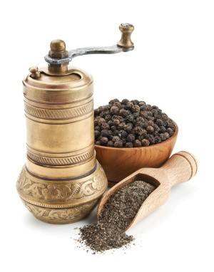 Peppercorns and a pepper mill.