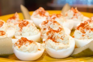 Deviled eggs being served as a holiday appetizer.