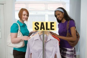 2 women shopping at a sale