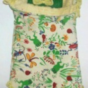 Flower print homemade sleeping bag for dolls.