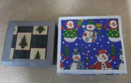 Boxes wrapped in Christmas paper and edged with duct tape.