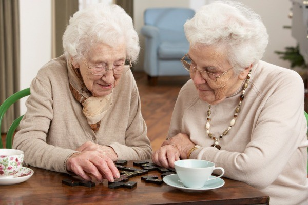 Nursing home games ideas thriftyfun two elderly women playing dominos negle Choice Image