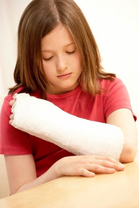 A girl with a broken arm.