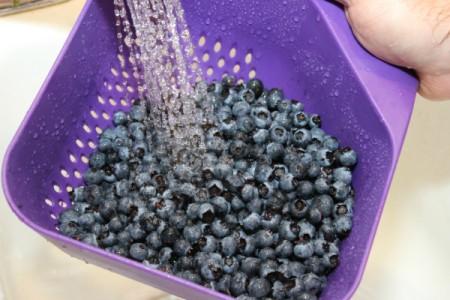 rinsing blueberries