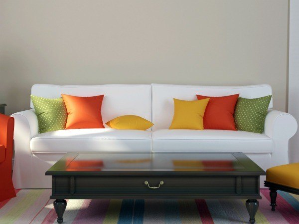 A White Couch With Colorful Pillows.