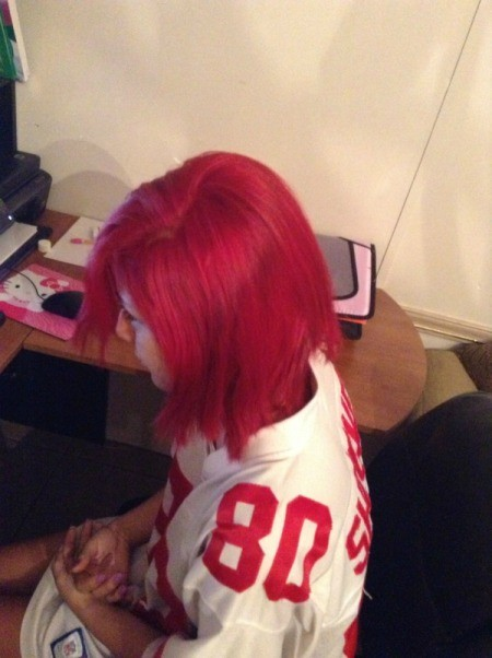 Girl with bright red hair.