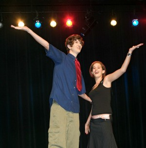Two high school students performing a skit.