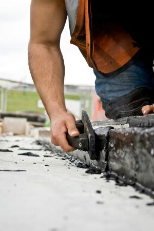 man applying tar