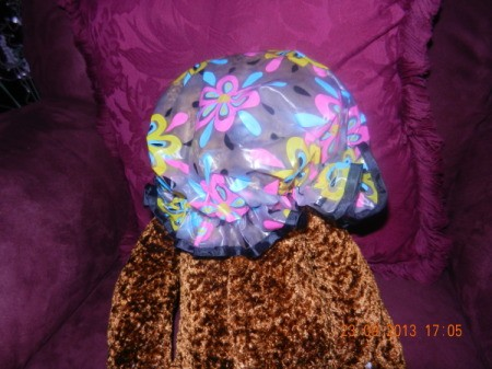 Shower cap with pastel flower design.