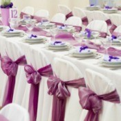 Photo of a wedding reception decorated in purple.