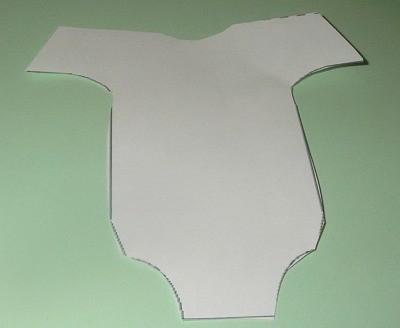 Cut out of template on sitting against green paper.