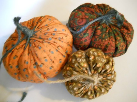 Three yo yo pumpkins.