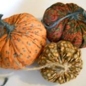 Three yo yo pumpkins.