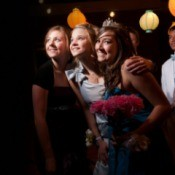 3 girls at a homecoming dance.