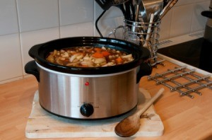 Crockpot with a healthy stew cooking in it.
