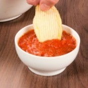 Eating chips and salsa.