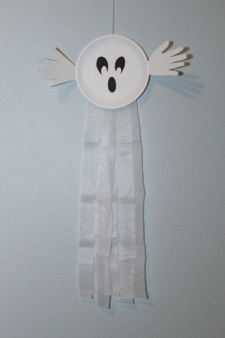 paper plate ghost on wall