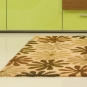 A rug sitting on a vinyl floor.