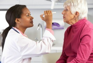A woman being examined by her doctor.