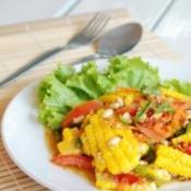 Lettuce, tomato and corn salad.