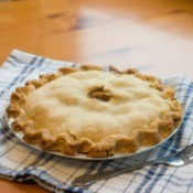 An apple pie with a delicious looking pie crust.