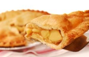 A piece of apple pie with crispy crust.